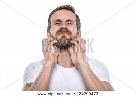 Adult male scratching beard isolated on white.