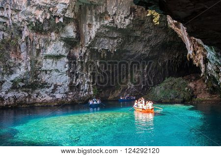 Cephalonia Greece - August 30 2015: Tourists take a boat trip on the beautiful Melissani Lake.