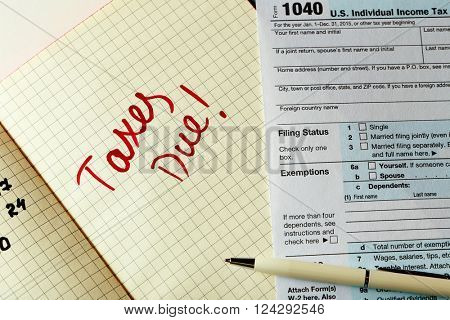 Taxes due written in a planner, close up