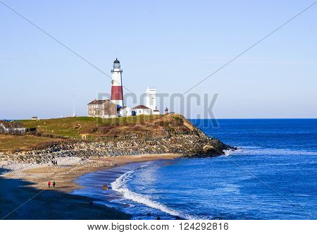 Atlantic ocean waves on the beach at Montauk Point Light, Lighthouse, Long Island, New York, Suffolk County in Winter