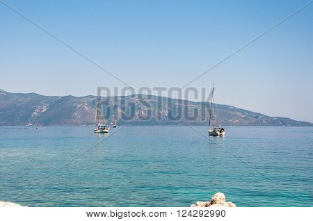 Yachts on the Ionian Sea with Itaka Island in the background Greece ** Note: Visible grain at 100%, best at smaller sizes