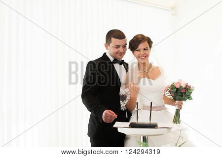 Bride And Groom On Marriage Registration. The Groom Looks At The