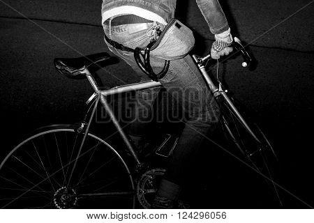 Modern city dweller on the road bike close up at night