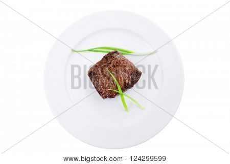 meat food : roasted fillet mignon on white plate with green sprouts isolated over white background