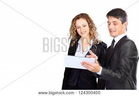 Successful young business team. Man and woman isolated over white with tablet.