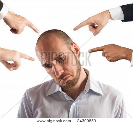 Businessman with sad expression shown by people