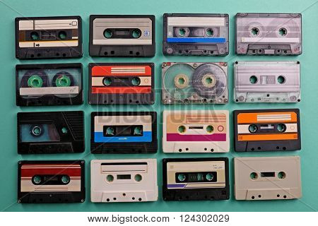 Set of old audio cassettes on turquoise background