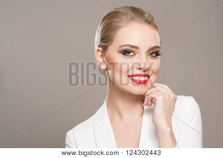 Gorgeous Blond Woman In Festive Makeup.