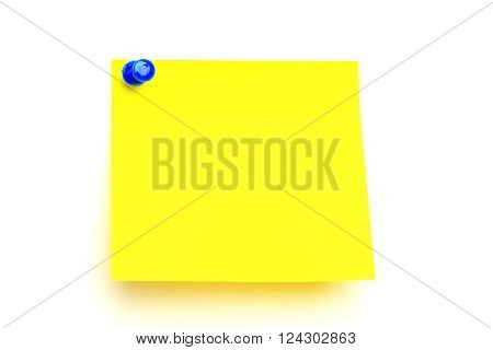 yellow paper pinned to a white background