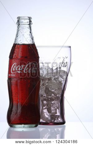 KUALA LUMPUR, MALAYSIA - Feb 17, 2016 bottle of Coca Cola soft drinks and a glass with ice cube