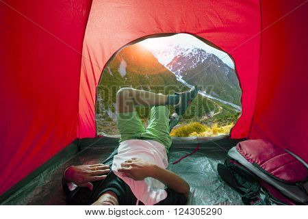 Camping Man Lying In Outdoor Camping Tent With Beautiful Natural Scenic