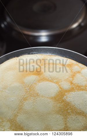 Frying pan with pancake baking on it ** Note: Soft Focus at 100%, best at smaller sizes
