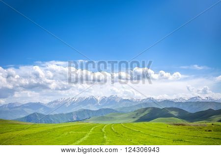 Beautiful landscape with green mountains and magnificent cloudy sky