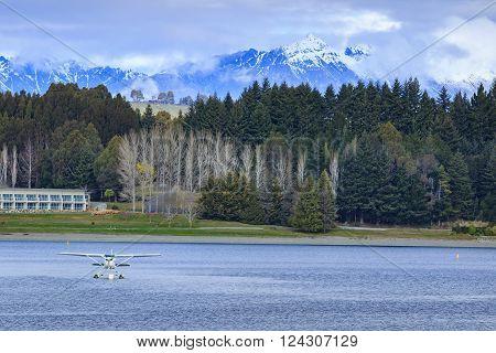 Water Plane Floating Over Fresh Water Lake Against Beautiful Mountain Scenery In Lake Te Anau New Ze