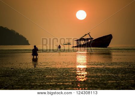 sun rise and old boat at coastal