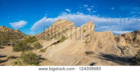 Massive sandstone geologic rock formation at Vasquez Rocks in the Mojave desert of southern California.