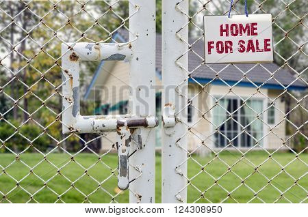 Home For Sale and Real Estate Sign on wire mesh fence