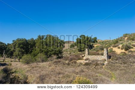 Stone columns mark the remains of a homestead in the hills near Los Angeles California.