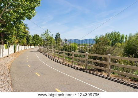Sun shines down on a walking and biking trail in the southern California town of Santa Clarita.