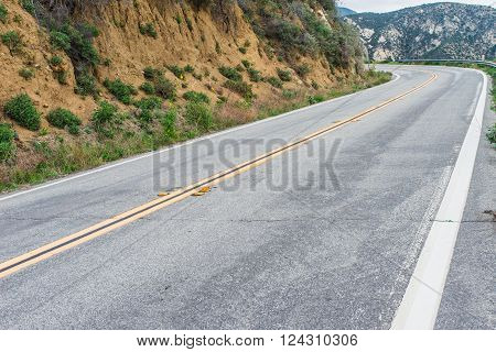 Long straight stretch of road leads up into the Angeles Mountains above Los Angeles in southern California.