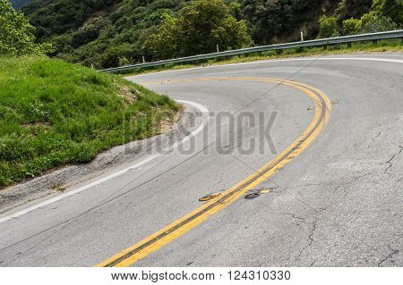 Road banks in a sharp bend in southern California mountains near Los Angeles.