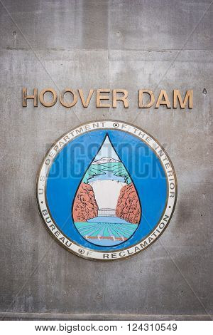 Old sign labels the side of a building at the Hoover Dam in the southwest United States.
