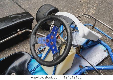 Go kart racing steering wheel, selective focus