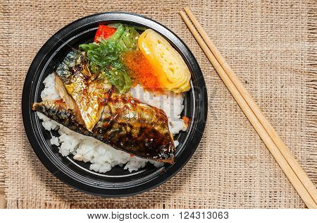 Japanese food style Saba fish grilled set with rice on cloth background in still life style