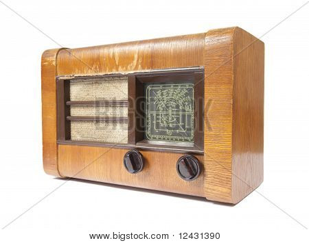 Old wooden radio isolated on white