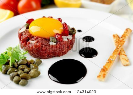 Beef tartare served on a plate, close up
