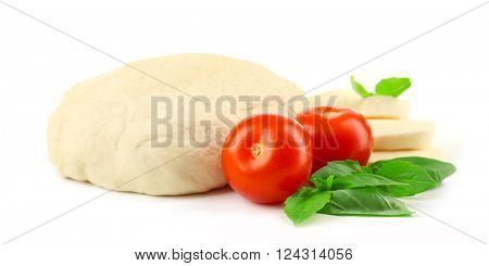Fresh dough and other ingredients for pizza isolated on white
