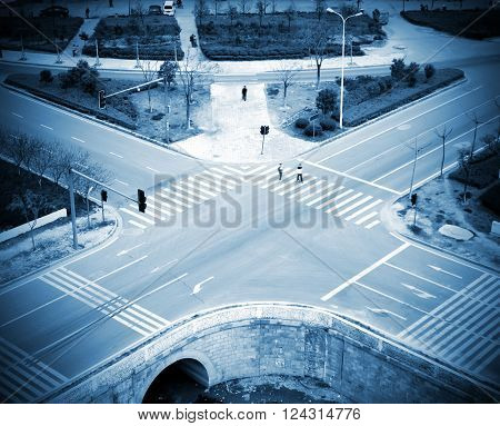 Modern urban road intersection, blue tone picture