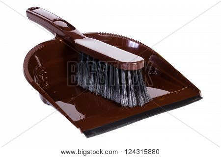 New brown brush broom with dustpan for cleaning on white background concept of household duties