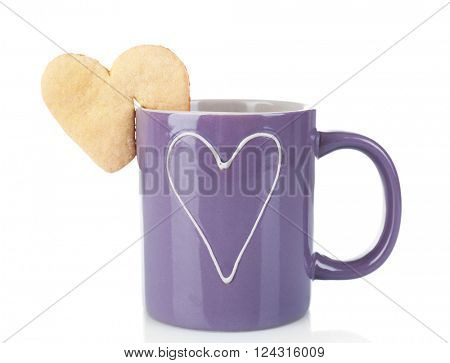 Heart shape cookie on cup of coffee isolated on white