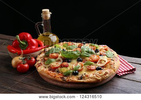 Delicious fresh pizza on black background