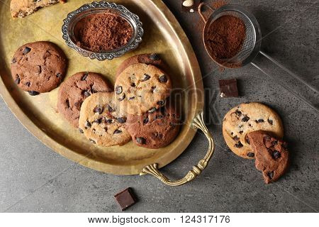 Chocolate chip cookies on a metal tray, top view