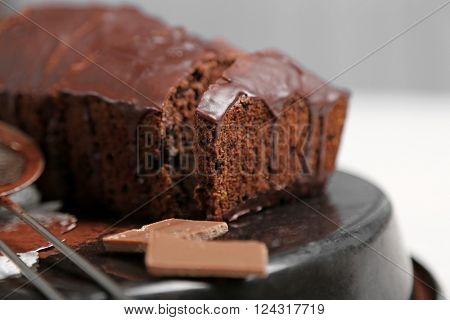 Chocolate sliced cake with icing on baking dish