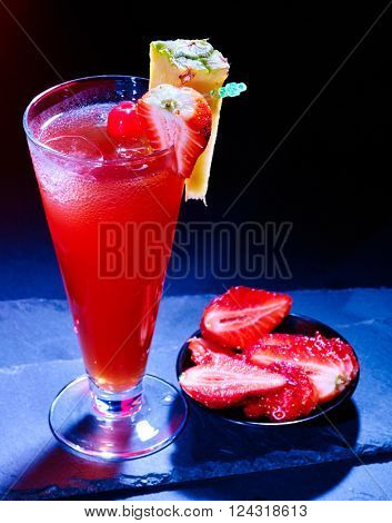 Red raspberry drink  with pineapple slice on black background. Cocktail card 91.