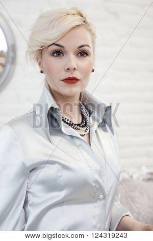 Portrait of retro style businesswoman, looking away.