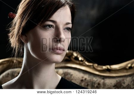 Closeup portrait of natural young woman looking away, daydreaming.