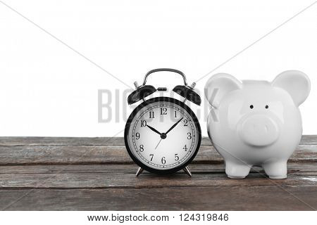 White piggy bank and clock on white background