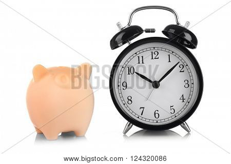 Beige piggy bank and clock isolated on white
