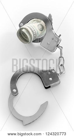 Handcuffs with rolled dollar banknotes, isolated on white. Corruption concept