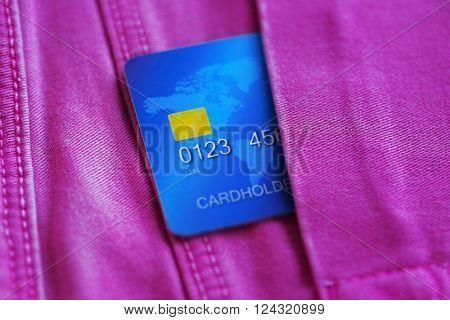 Credit card in jeans pocket, close up