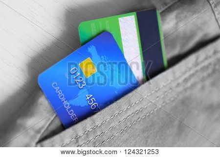 Credit cards in trouser pocket, close up