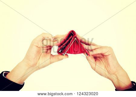 Business woman looking into her empty wallet