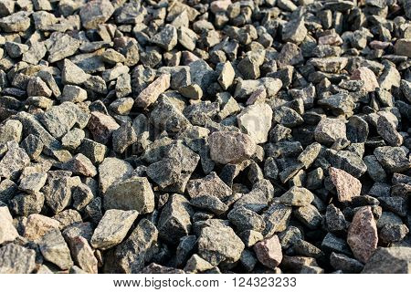 Gray granite gravel closeup. Background granite gravel