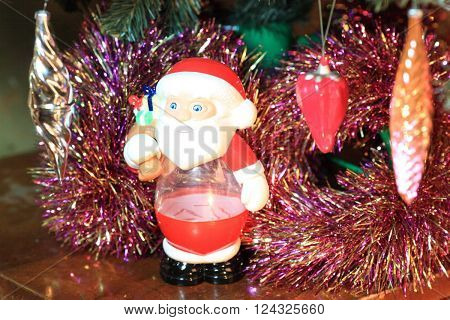 image of many toys on green christmas fir