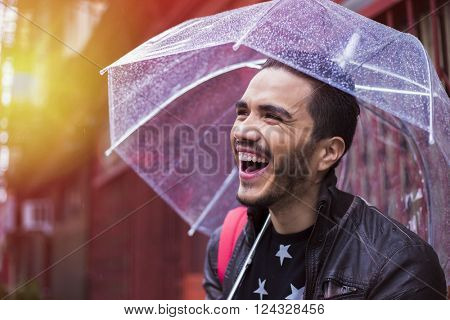 Man with a worried expression with umbrella under the rain