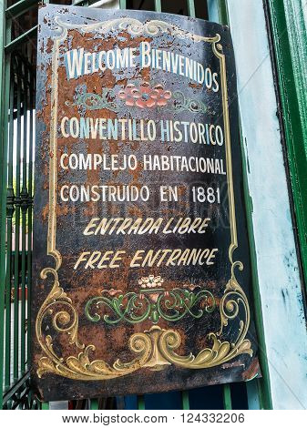 Buenos Aires Argentina - December 16 2012: Street sign for the famous historic tenement housing complex built in 1881 in La Boca Buenos Aires. The sign is attached to the gate at La Boca Buenos Aires.